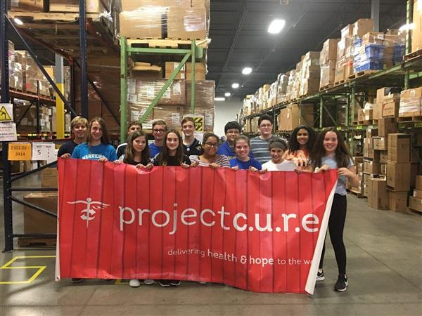 Project Cure Gets a Hand From Our EMM Club
